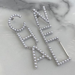 Chanel big initial pearl earrings